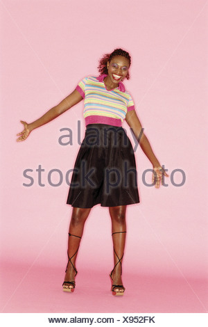 Young woman in black skirt - Stock Photo