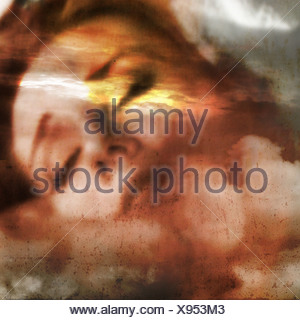dream image of a woman with eyes closed in the clouds - Stock Photo