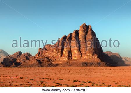 Seven Pillars of Wisdom, mountain, plain, desert, Wadi Rum, Hashemite Kingdom of Jordan, Middle East, Asia - Stock Photo