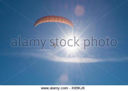 Paraglider, aviation, paragliding, blue sky, flight to the sun, Bassano, Veneto, Italy - Stock Photo