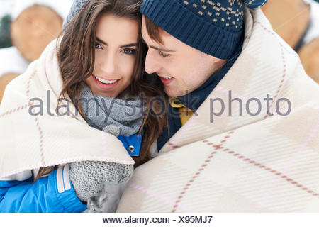 Snuggling up with a loved one in winter. Debica, Poland - Stock Photo