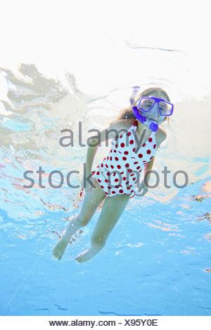 USA, Florida, St. Petersburg, Girl (10-11) diving in swimming pool - Stock Photo