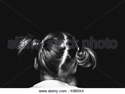 Rear view of a girl with pigtails - Stock Photo