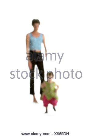 Silhouette of woman and child, on white background, defocused - Stock Photo