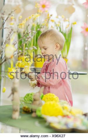 Little Girl Playing With Easter Decoration, Osijek, Croatia, Euope - Stock Photo