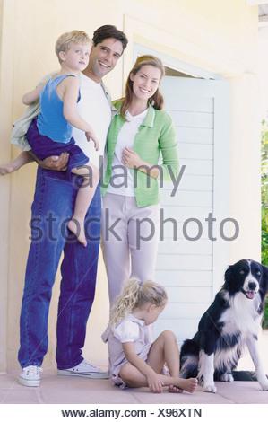 Family on porch - Stock Photo