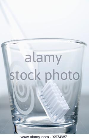 Tumbler, toothbrush, close up - Stock Photo