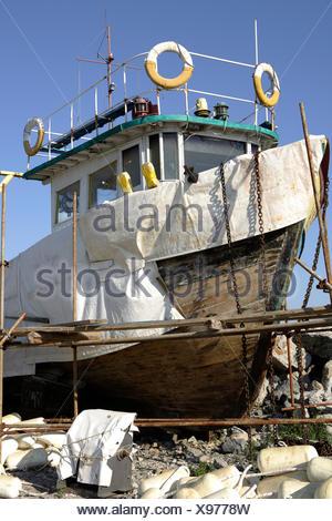 Boat being repaired, fishing port, Chernomorets, Bulgaria, Europe - Stock Photo