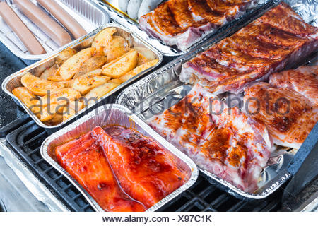 Grilled meat and sausages on a grill - Stock Photo
