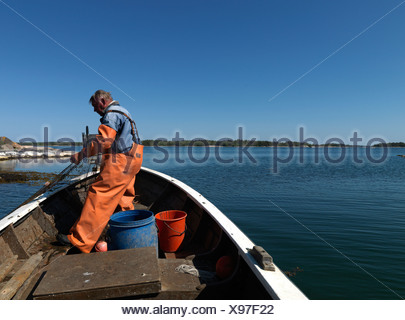 A fishing man in a boat Sweden. - Stock Photo