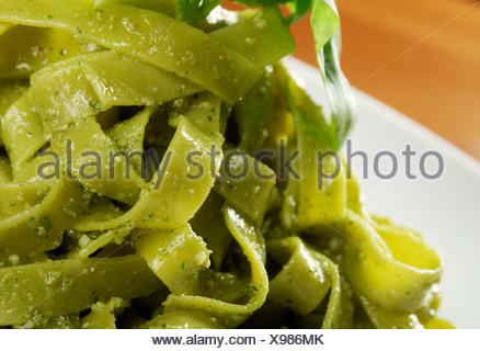 Tagliatelle pasta with pesto - Stock Photo