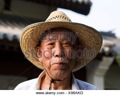 Closeup of mature man with straw hat - Stock Photo