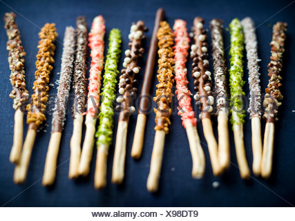 Different flavored chocolate Mikados - Stock Photo