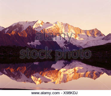 Reflection of mountains in water, Lake Prebersee, Lungau, Salzburg, Austria - Stock Photo
