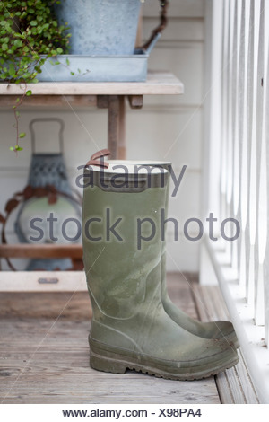 Rubber boots by railing - Stock Photo