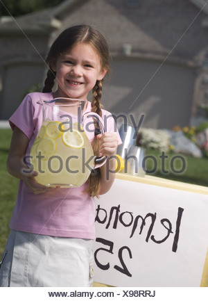 Portrait of a girl holding a jar of lemonade - Stock Photo
