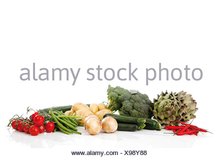 Mixed vegetables, artichokes, broccoli, potatoes, zucchini, onions, beans, cucumber, tomatoes and chillies - Stock Photo