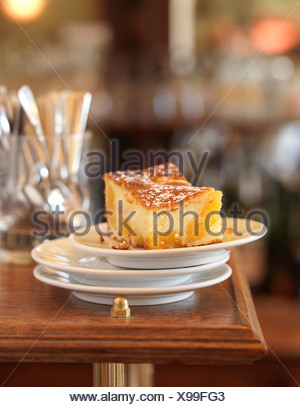 Portion of apricot batter pudding - Stock Photo
