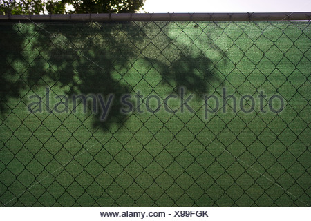 Green screen on wire fence - Stock Photo