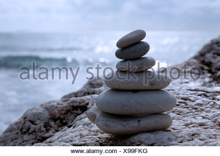 Tower made of pebbles on the beach - Stock Photo