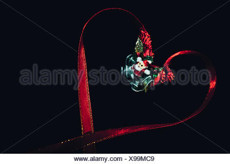 Close-Up Of Hear Shaped Christmas Decoration Against Black Background - Stock Photo