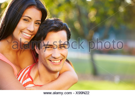 Outdoor Portrait Of Romantic Young Couple In Park - Stock Photo