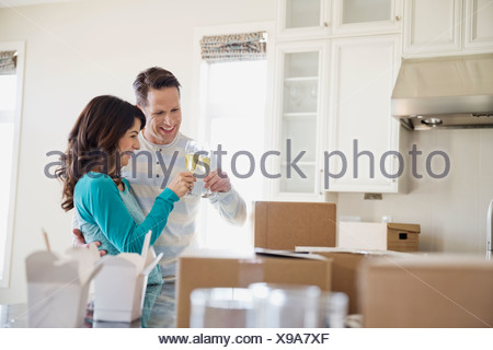 Couple toasting new home with champagne - Stock Photo