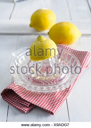 Lemons on lemon squeezer - Stock Photo