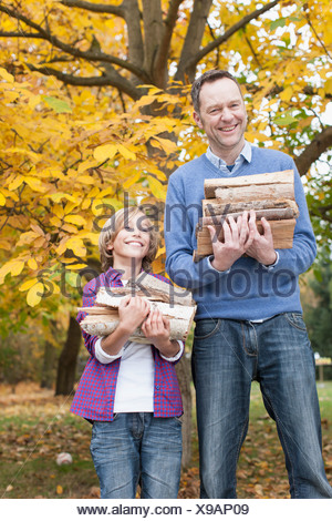 Germany, Leipzig, Father and son collecting firewood - Stock Photo