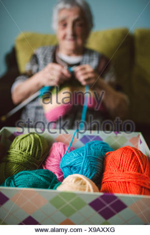 Box of different balls of wool - Stock Photo