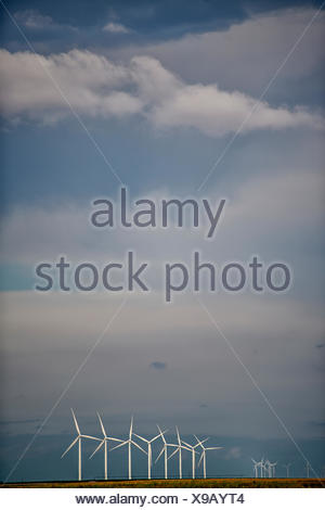 Wind Turbines On Field Against Sky - Stock Photo