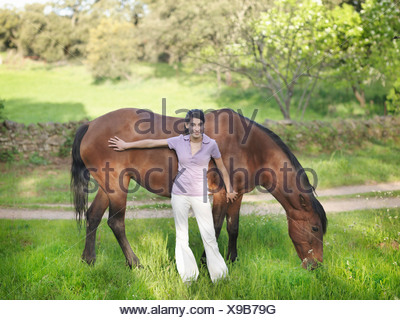 Girl stroking horse - Stock Photo
