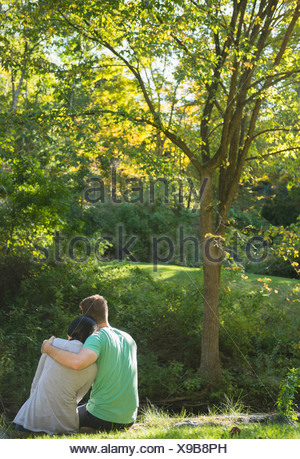 USA, Connecticut, Newtown, Couple sitting in park - Stock Photo