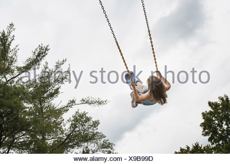 A girl on a rope swing high in the air Woodstock New York USA USA
