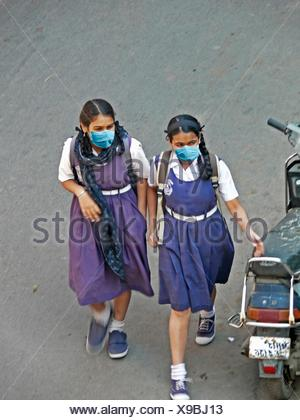 Schoolgirls, Precaution Mask for Swine Flu, H1N1 - Stock Photo