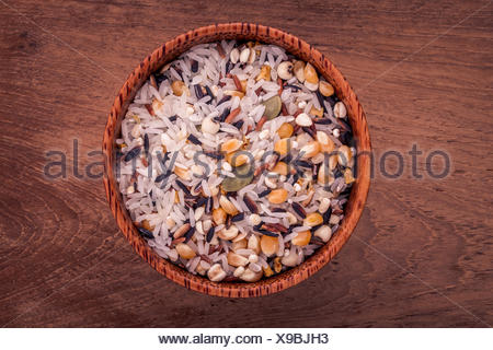 Mixed Whole grain Traditional Thai rice in the spoon and bowl be - Stock Photo