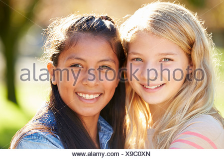Portrait Of Two Pretty Girls In Countryside - Stock Photo