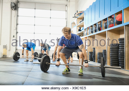 Man getting into position for clean and jerk lift - Stock Photo