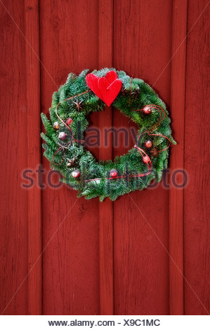 Close-up of a Christmas wreath on wooden door - Stock Photo