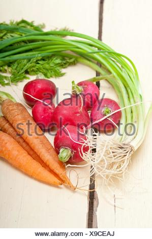 raw root vegetable on a rustic white wood table. - Stock Photo