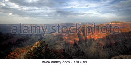 The sun sets in the Grand Canyon from Point Sublime at Grand Canyon National Park, Arizona. - Stock Photo