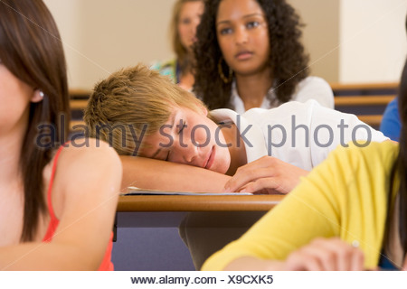 Student in class sleeping (selective focus) - Stock Photo