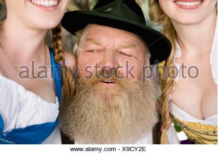 Germany, Bavaria, Upper Bavaria, Senior man and two women, portrait, close-up - Stock Photo