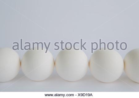 free range organic eggs arranged in row - Stock Photo