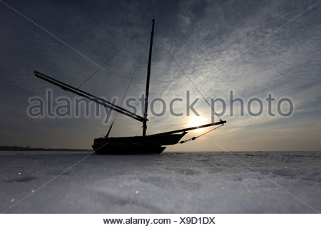 Wustrow, Germany, silhouette, sailing boat lying on the frozen Baltic - Stock Photo