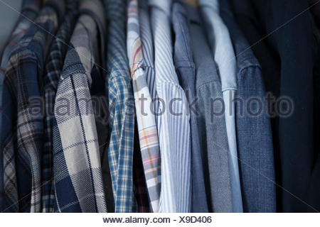 Side view of shorts on hangers in row on clothes rack - Stock Photo