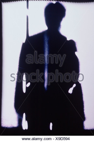 Degraded impression image of silhouetted figures of office workers. - Stock Photo