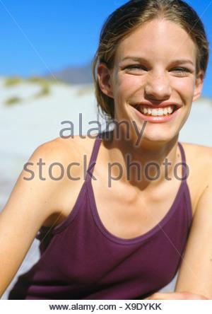 Woman laughs at camera - Stock Photo