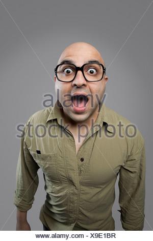 Bald man surprised