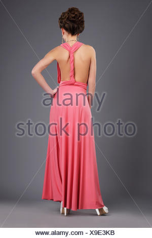 Rear View of Shapely Lady in Evening Gown - Stock Photo